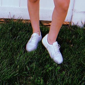 White JSLIDE sneakers.